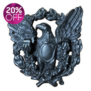 Black cast iron regal eagle door knocker. This very proud eagle sits adorned with a bouquet of flowers that forms the knocker section - SHOP NOW - www.intovintage.co.uk
