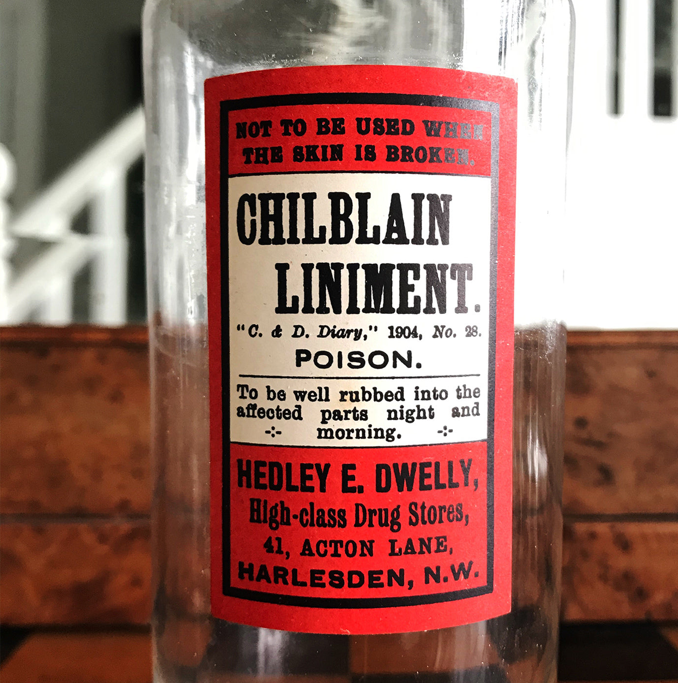 Vintage Apothecary Bottle with an original paper Poison label for Chilblain Liniment, Poison from Hedley E. Dwelly, High-Class Drug Stores, 41, Acton Lane, Harlesden. N.W. London - SHOP NOW - www.intovintage.co.uk