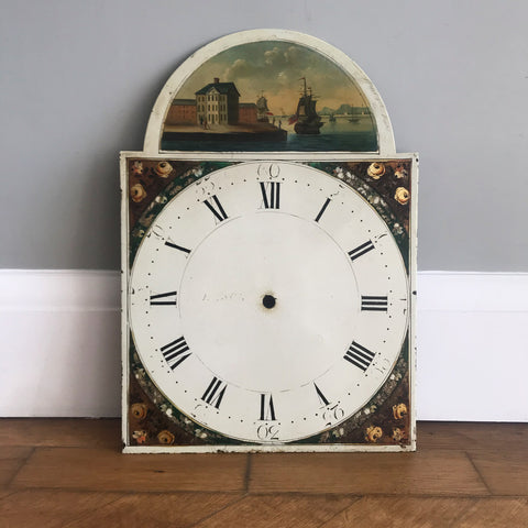 Beautiful Antique Clock Face by Johnson of Knaresboro. It has a charming harbour scene with a couple strolling along a period waterside quay and two naval frigates in full sail showing the Royal Navy flag - SHOP NOW - www.intovintage.co.uk
