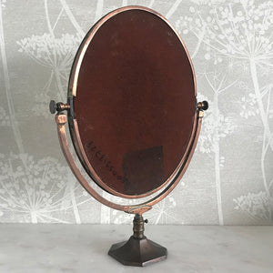 A very pretty Vintage Copper Shop Counter Mirror from an old Leigh on Sea haberdashery shop C.1930. The original mirror plate, that swivels in the frame, is bevelled and has a slight foxing on it. Great patina on the copper. Would look great in the bathroom or on the dressing table - SHOP NOW - www.intovintage.co.uk