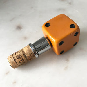 Three deep orange vintage dice all doing a job... One sits atop your bottle replacing the cork, pull off the dice and it becomes a pourer. The second dice is your corkscrew whilst the third dice opens your beer bottles - SHOP NOW - www.intovintage.co.uk