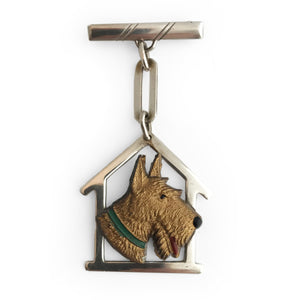Lovely silver and plastic Art Deco pin. The early plastic dogs head sits on a silver house shaped kennel with chain and pin. Marked Silver - SHOP NOW - www.intovintage.co.uk