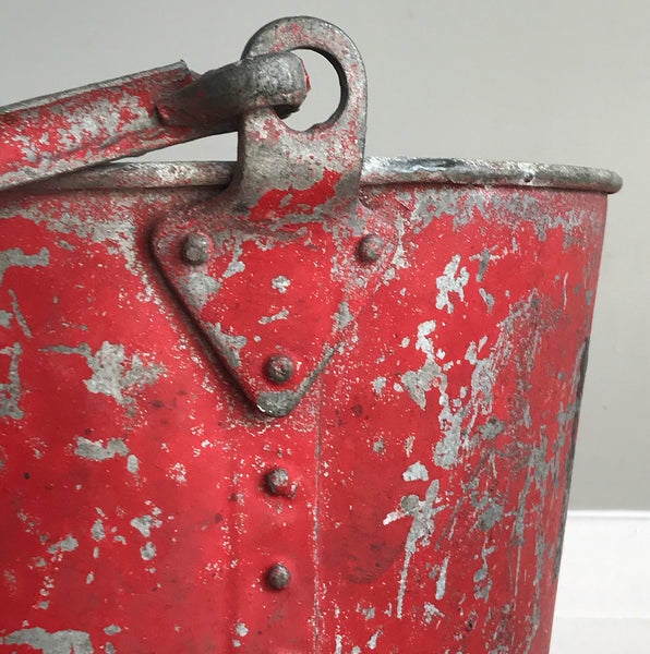 Vintage riveted, galvanised steel fire bucket with a wonderful distressed patina to it's red surface - SHOP NOW - www.intovintage.co.uk