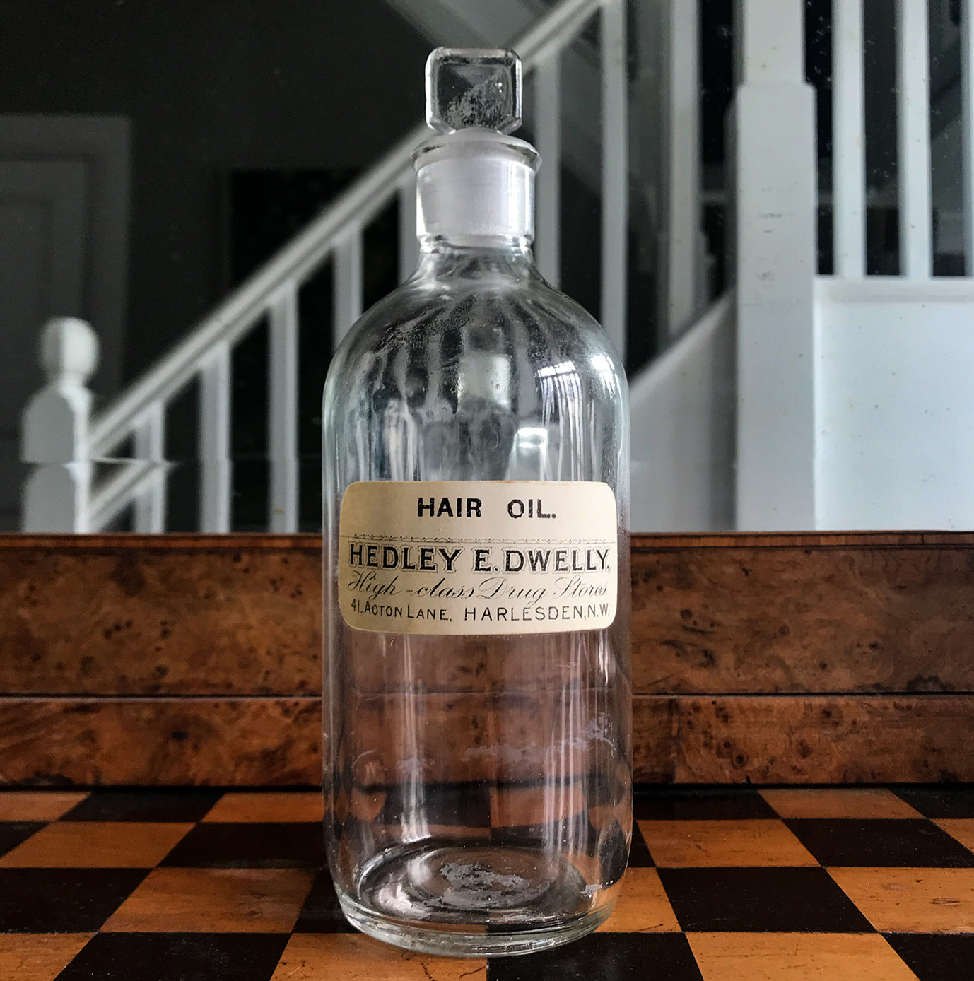 Vintage Clear Apothecary Bottle with an original paper label from Hedley E. Dwelly, High-Class Drug Stores, 41, Acton Lane, Harlesden. N.W. - SHOP NOW - www.intovintage.co.uk