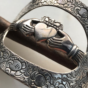 Charming Iris Silver & Wood Claddagh Hair Clasp. The marked 925 (silver) ring is beautifully decorated around the outer edge with the Irish emblem of two hands holding a heart which depicts love, loyalty, and friendship - SHOP NOW - www.intovintage.co.uk