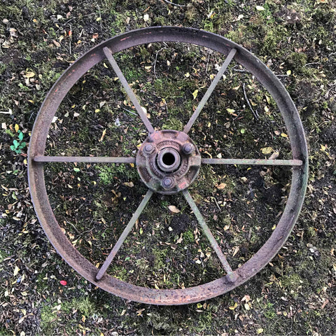 A Pair of Vintage Cast Iron Wheels