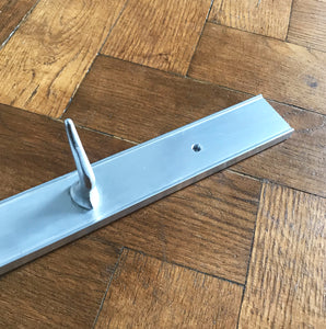 Long Vintage Meat Hook Rack from Belgium. The rack is made of aluminium and has 7 solid aluminium hooks that are bolted from the back -SHOP NOW - www.intovintage.co.uk