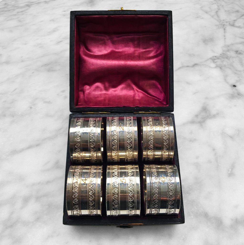 Nice set of 6 Edwardian Napkin Rings in a leather and satin case. Each ring is numbered from 1 to 6. Unmarked but probably silver plated - SHOP NOW - www.intovintage.co.uk