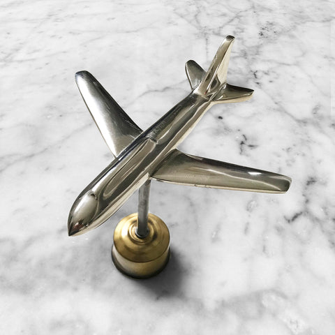 Stylish chrome plane on integral brass stand by interior designers' favourite, Andrew Martin. Would make a lovely work of art for your office or home - SHOP NOW - www.intovintage.co.uk