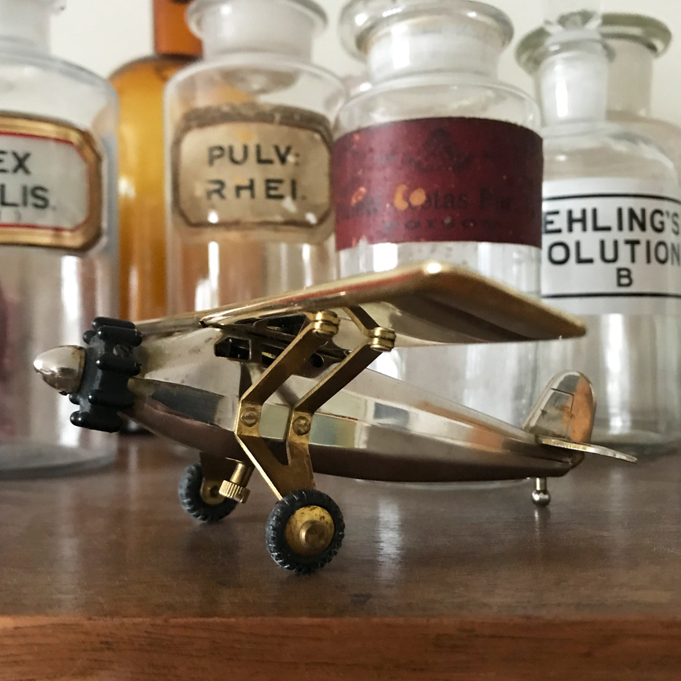 Working rare Spirit of St Louis airplane table lighter made by the Swank company of 1950s out of Japan. Amazing vintage piece in perfect working condition. This is a semi-automatic piece. Just spin the nose cone, and the cockpit flips open activating the lighter - SHOP NOW - www.intovintage.co.uk