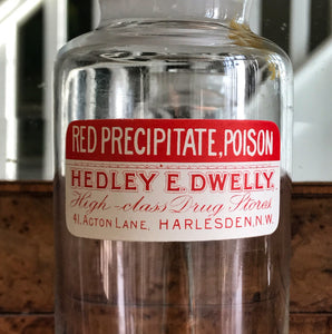 Vintage Clear Apothecary Poison Bottle with an original paper label from Hedley E. Dwelly, High-Class Drug Stores, 41, Acton Lane, Harlesden. N.W. London - SHOP NOW - www.intovintage.co.uk
