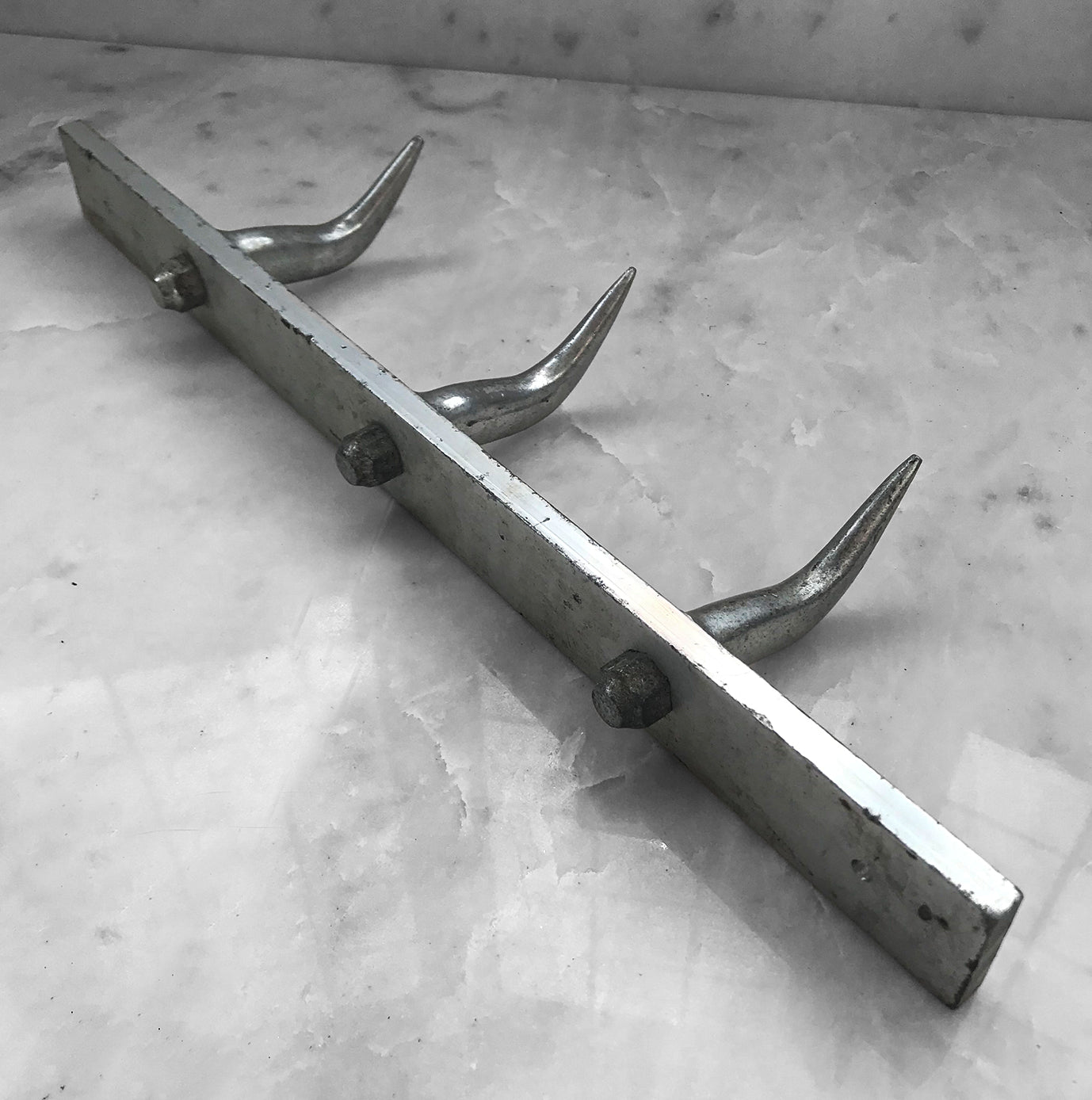 Nice Vintage Meat Hook Rack from Belgium. The rack is made of aluminium and has 3 substantial hooks that are bolted from the back - SHOP NOW - www.intovintage.co.uk