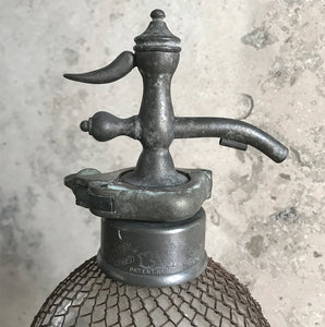 An early English soda syphon of double gourd form with a metal wire mesh net to the body, stamped 'British Syphon Company London'. Circa 1890 - SHOP NOW - www.intovintage.co.uk