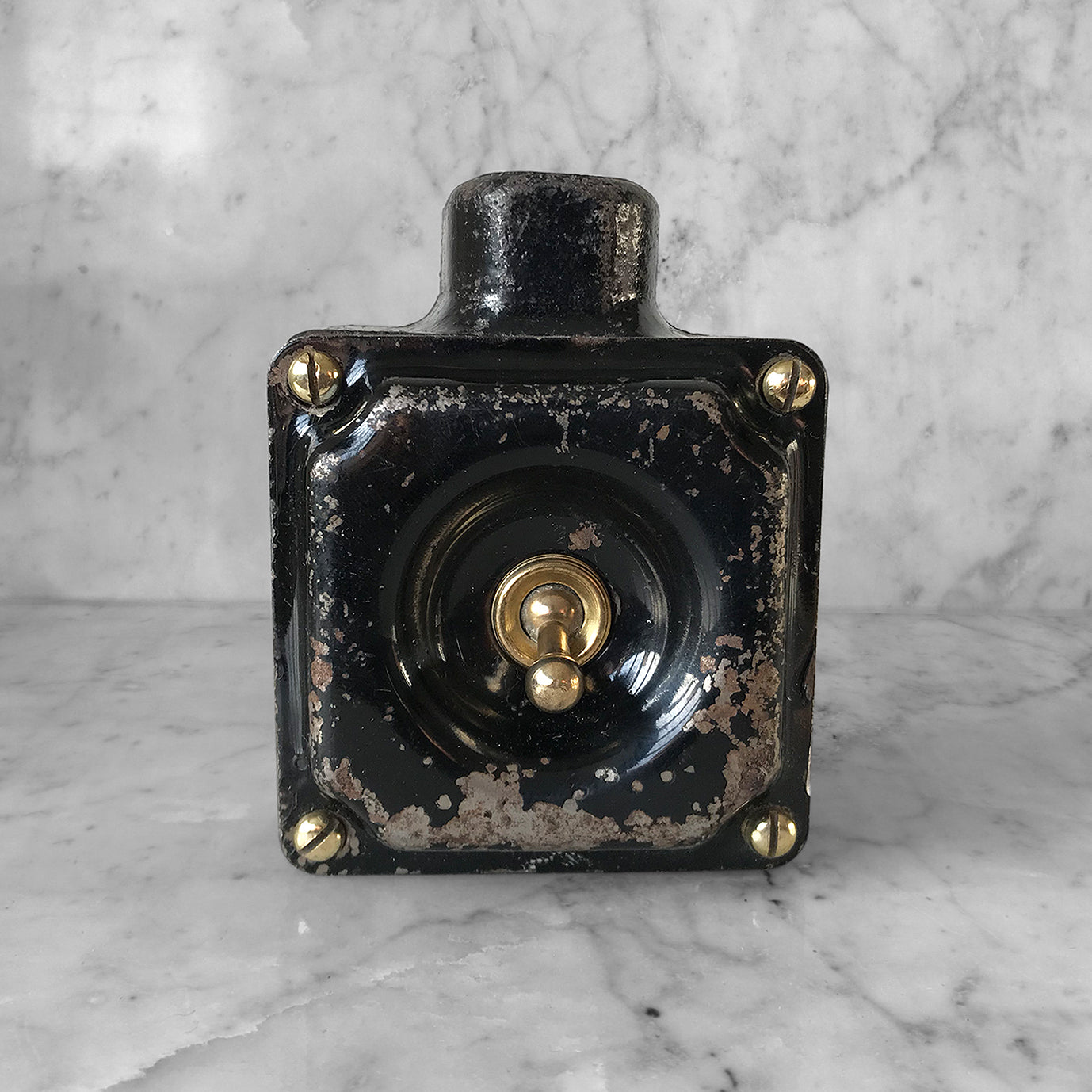 Metal Industrial Switch with a cast iron main body, pressed steel cover with brass toggle switch and brass cover screws with original finish. We have 3 of these switches in stock - SHOP NOW - www.intovintage.co.uk