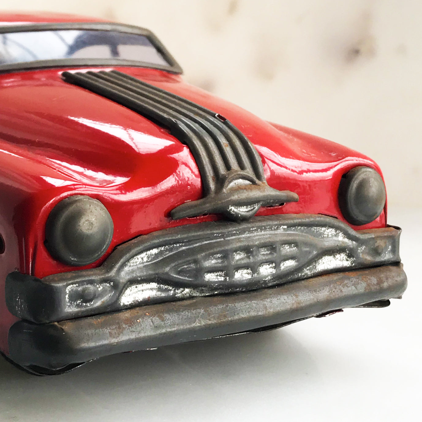 "Cool 1950s tin-plate Pontiac toy car by ""Minister Delux"". It has a friction movement, good body work and plastic windows/screens to front and back - SHOP NOW - www.intovintage.co.uk"