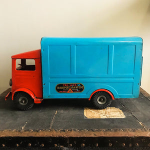 Cool Vintage Tri-ang Van No 200. The cab and wheel arches are finished in a popping red colour with the back storage section finished in a retro period light blue. It has two original Tri-ang decals on the sides and a pressed tin front radiator and lights - SHOP NOW - www.intovintage.co.uk