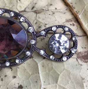 Beautiful quality Victorian brooch with a pale purple cut glass centre gem that is surrounded by a fabulous cut glass diamond studded border with two larger cut glass diamonds at each end - SHOP NOW - www.intovintage.co.uk