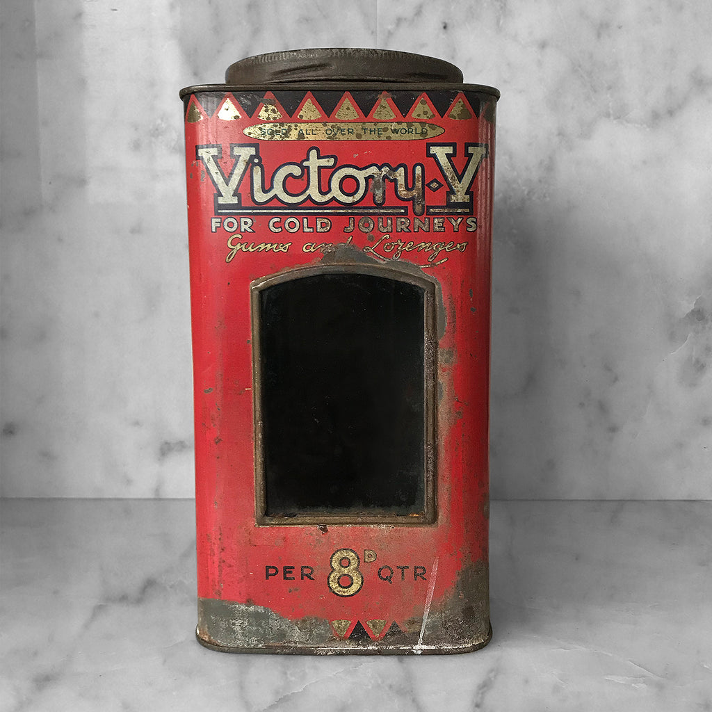 Antique Victory-V lozenge tin with glass window panel to the front, dating to around 1920. The tin has two lithographed panels to the sides, one being a fantastic image of the companies trademark sailor 'Jolly Jack', the other being an image of Horatio Nelson's Battle of Trafalgar flagship H.M.S. Victory.- SHOP NOW - www.intovintage.co.uk
