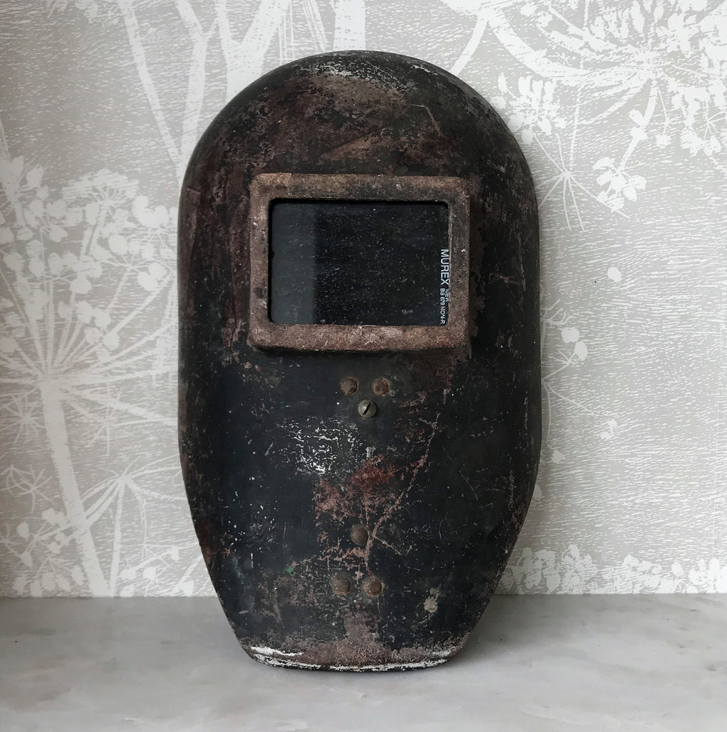 Fantastic Vintage Welders Mask with amazing patina. Constructed from fiberglass with a glass viewing screen marked 'MUREX'. It has a certain alien quality to it, think The Day The Earth Stood Still! Would look amazing hung on the wall - SHOP NOW - www.intovintage.co.uk