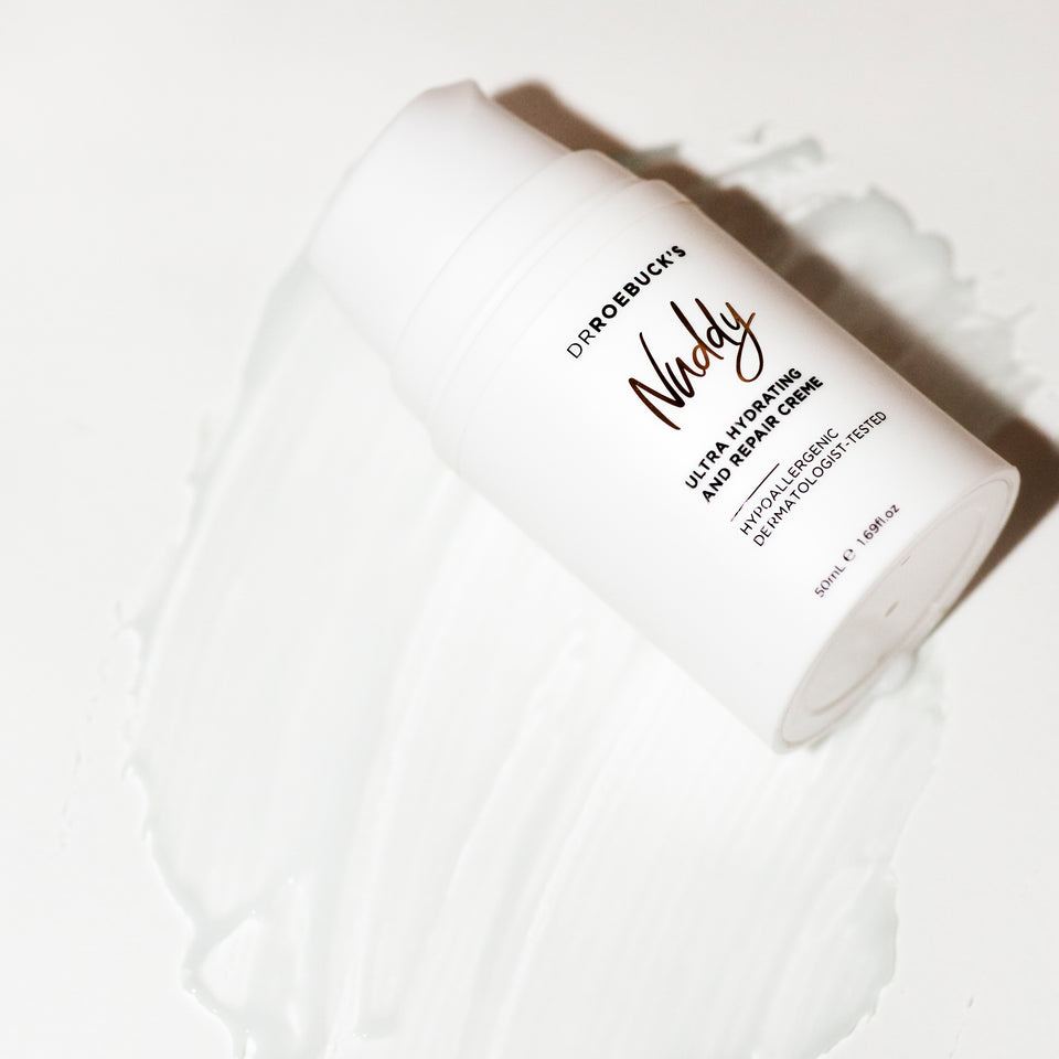 Dr Roebuck's Nuddy Ultra Hydrating and Repair Creme bottle with product showing texture on white background.