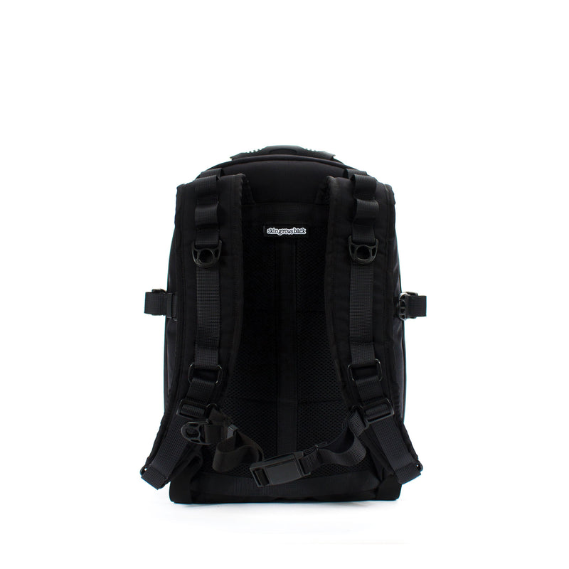 skingrowsback compak 16 litre backpack black back