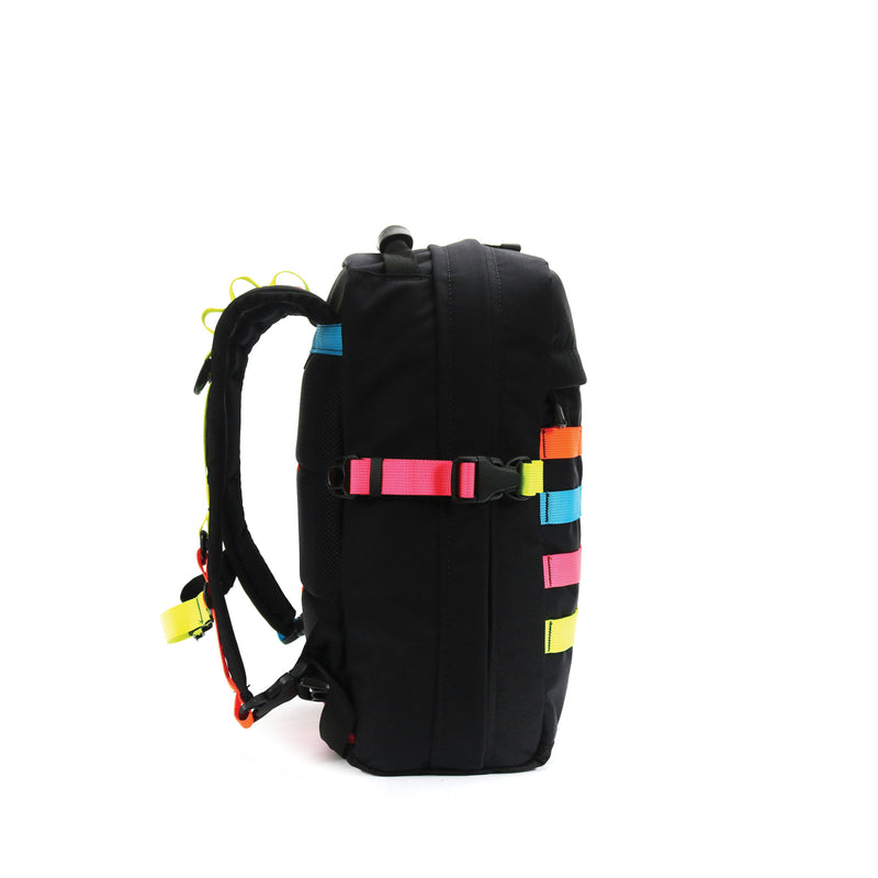 skingrowsback compak 16 litre backpack neon left