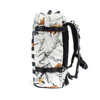 skingrowsback PAK30 30 litre backpack Snowfall right
