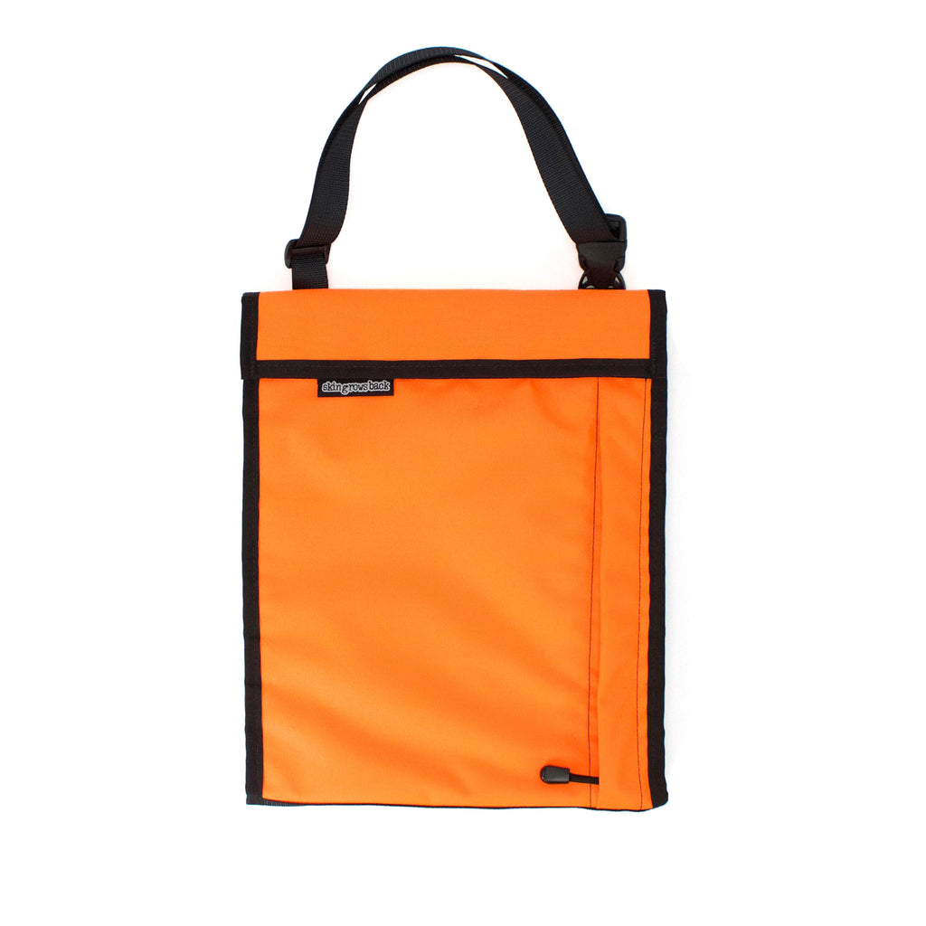 skingrowsback velodrome chainring bag track cycling neon orange