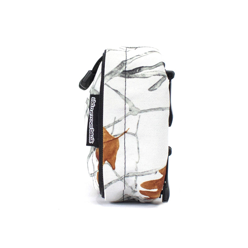skingrowsback cube mid modular pouch snowfall side
