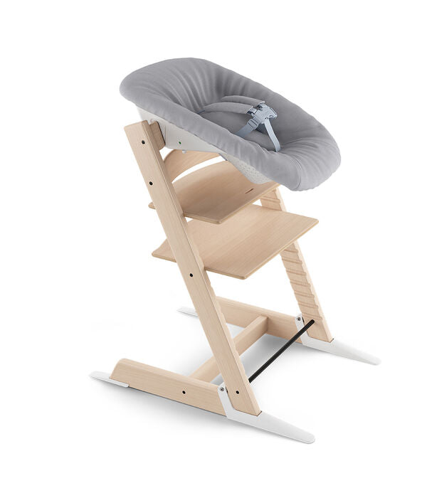 Stokke Tripp Trapp with the newborn set attached. It is grey with a harness.