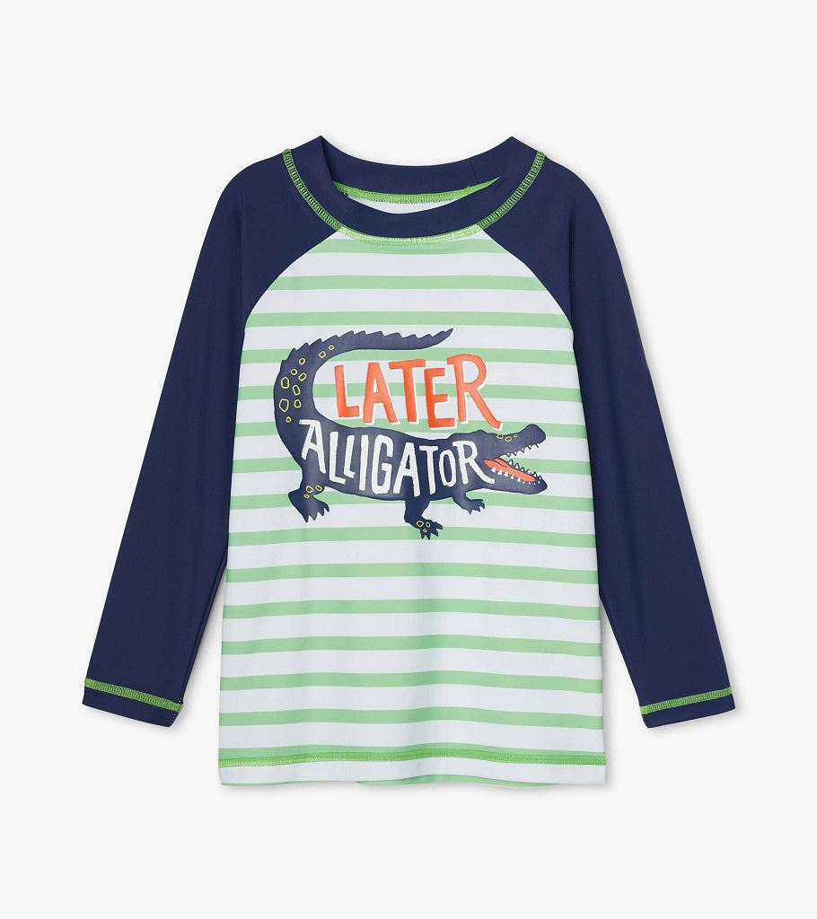 Hatley kids rashguard top. Navy Long sleeves and green and white striped body with and alligator and the  saying Later Alligator.