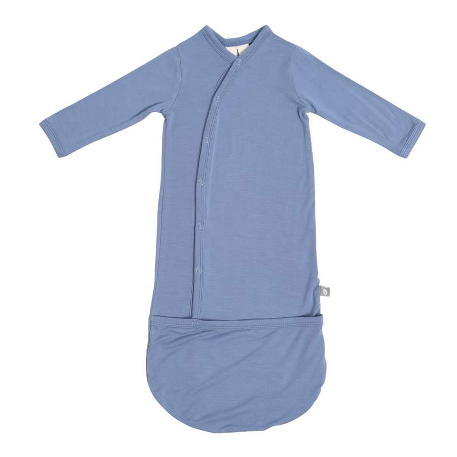 Kyte bundler in slate blue is like a gown that will keep your babies feet warm. It snaps to open.