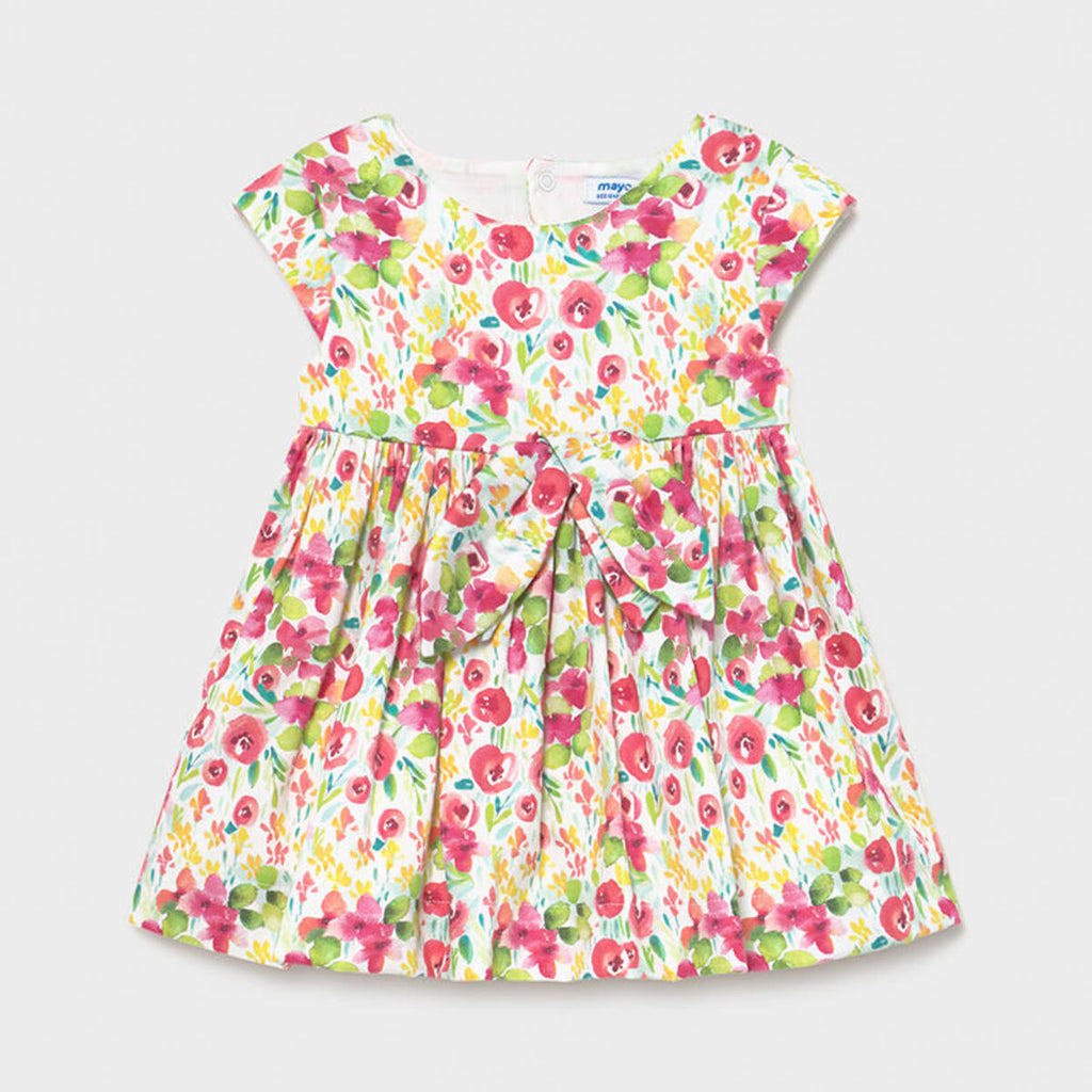 Pink, green and yellow floral pattern on this Mayoral dress with a big bow on the front.
