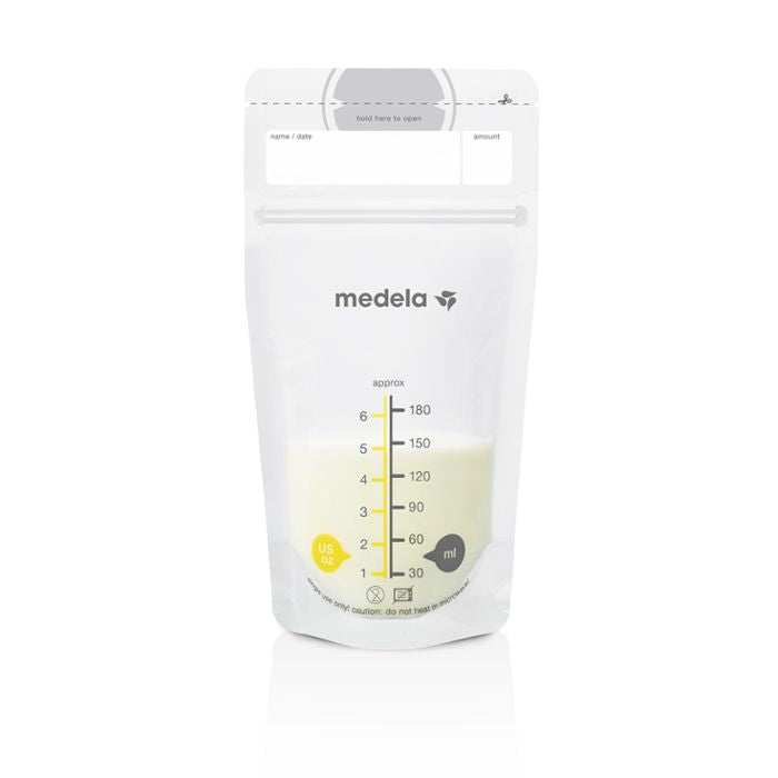 Medela breast milk storage bag with expressed breast milk inside. Standing bag with US ounces and millilitres  inscribed on front of bag.