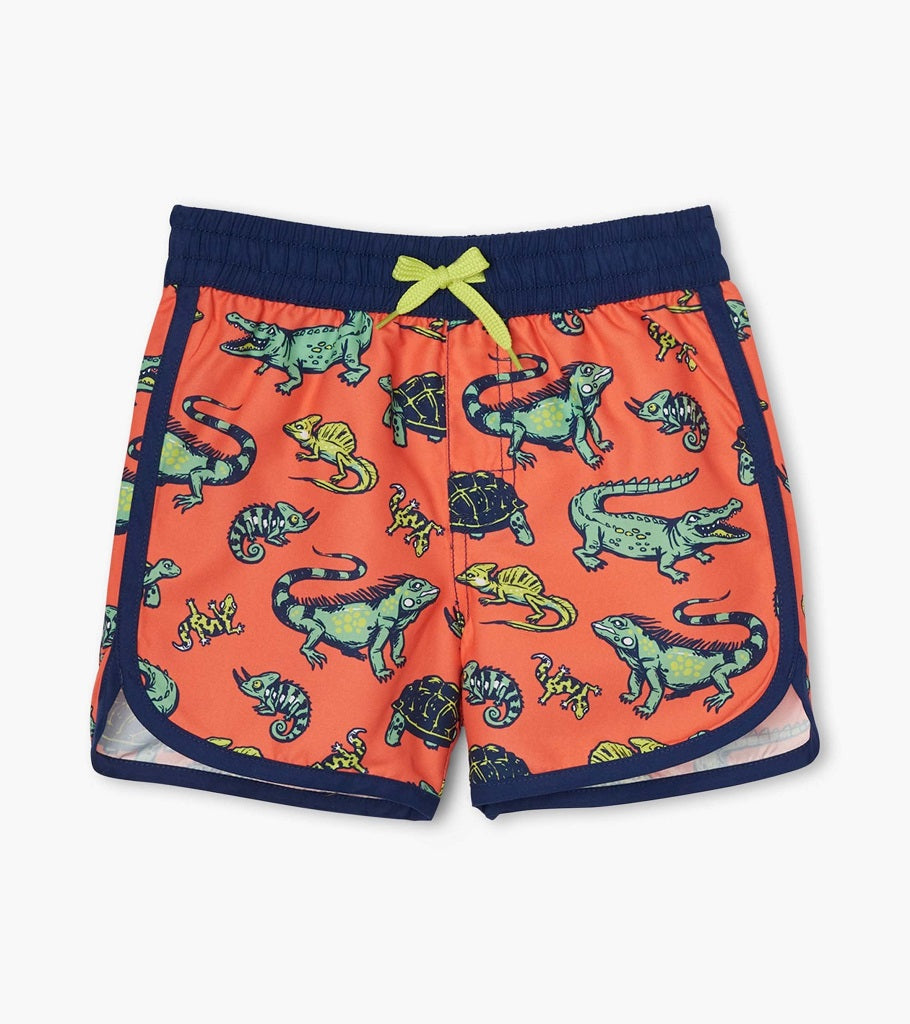 Hatley boys swim trunk with drawstring. Navy piping and waistband with orange background and green alligators and iguanas.