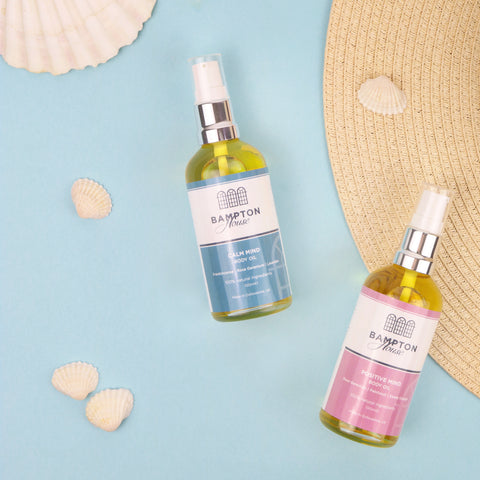 Body oils on a seaside backdrop with shells