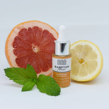 Bampton House 'Nourishing Cuticle Oil' in a 30ml bottle, alongside a slice of lemon, a slice of grapefruit, and a sprig of mint leaves. Made in Oxfordshire, UK from 100% natural ingredients, including grapefruit, jojoba, and frankincense.