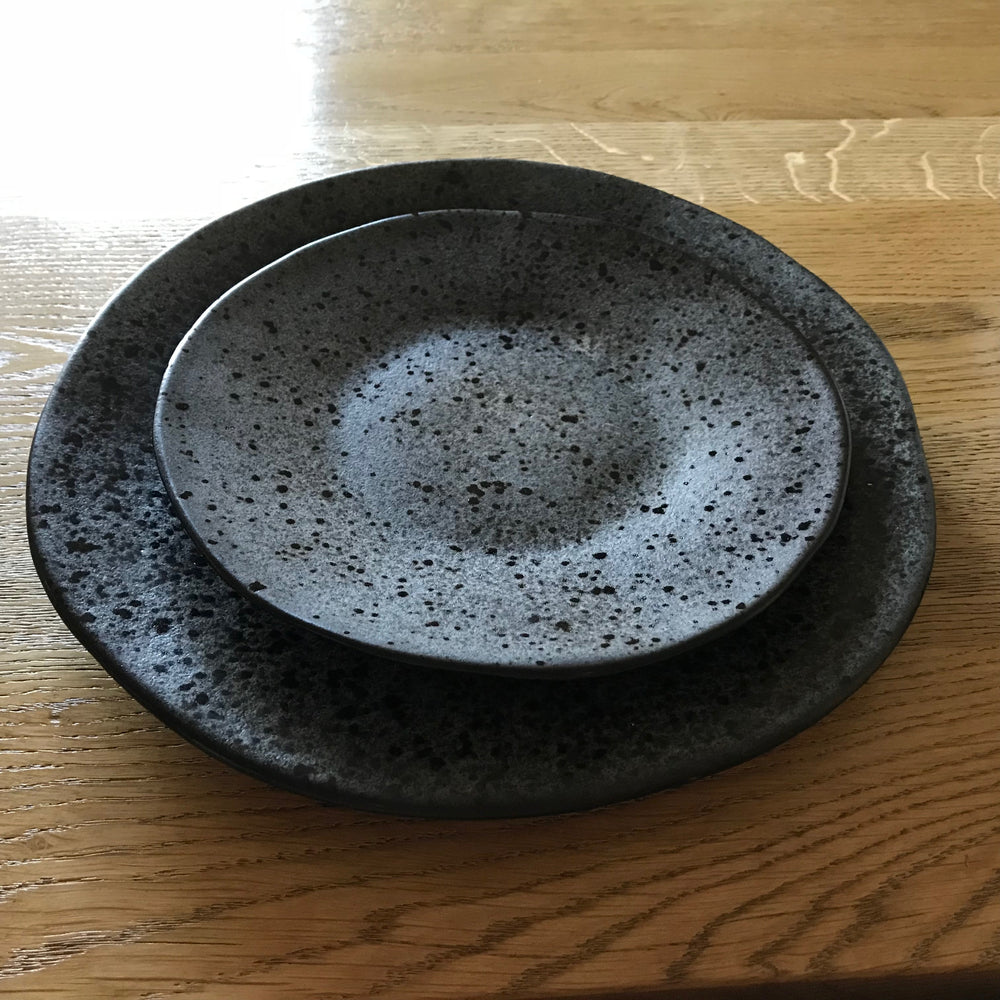 Black speckled ceramic dinner plate