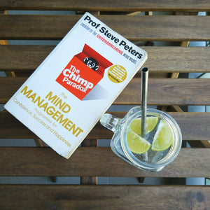 The Chimp Paradox book by author Professor Steve Peters and a drink with a metal straw