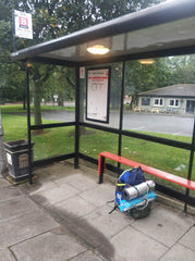 Bus stop Newcastle walking holiday back pack eco living