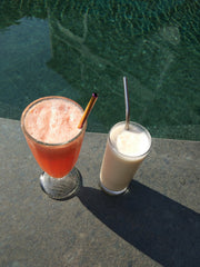 Watermelon smoothie poolside with metal drinking straw