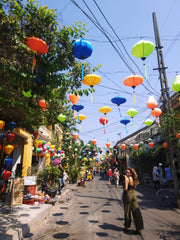 A picture of a street in Hoi An, Vietnam, with lanterns everywhere