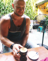 Joe, the author, drinking traditional Vietnamese coffee in Hoi An, Vietnam