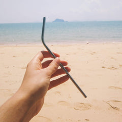 Metal straw on beach