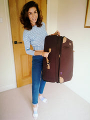 Kat with her old yet sturdy suitcase