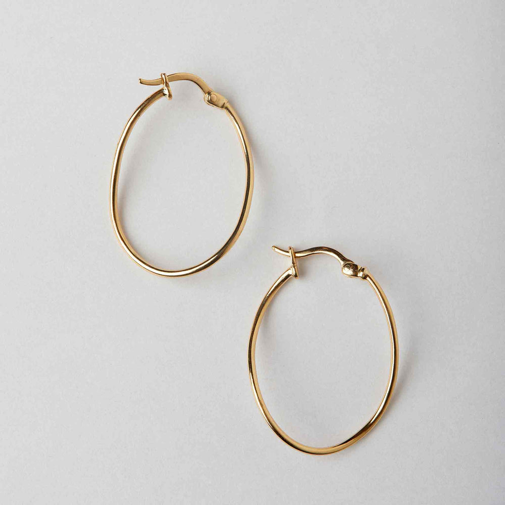 skinny gold twisted hoops