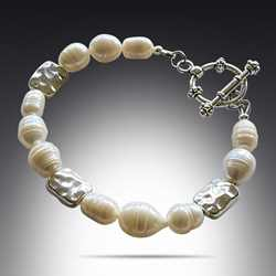 Freshwater Pearl Bracelet with Silver Pewter rectangle beads and toggle clasp. You can find this bracelet in my Freshwater Pearl Collection at creativejewelrybymarcia.com