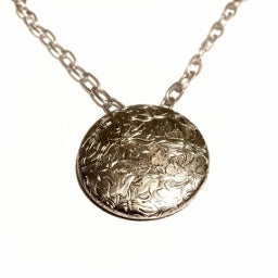This silver pendant necklace is made using stainless steel chain. The silver pendant was from an antique earring.