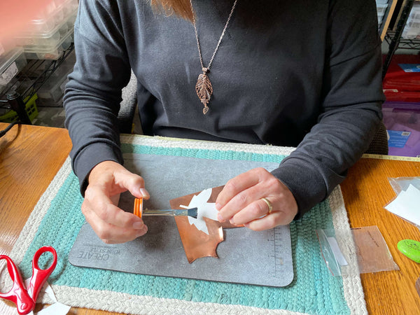 I am gluing the fall leaf template onto the copper. This leaf necklace is part of my Fall Leaf Collection at creativejewelrybymarcia.com.