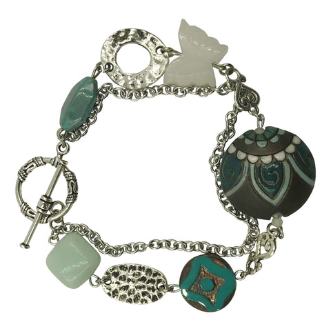 Silver Chain Bracelet, with clay focal round that has a paisley design. This bracelet also has seafoam square amazonite stones.